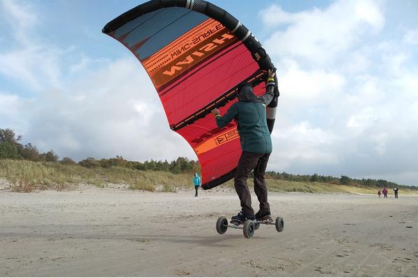 Wing surfer ir kalnų riedlente